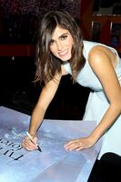 Nikki Reed with poster