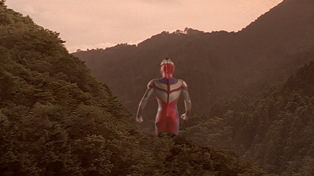 File:Tiga disappears after his mission.png