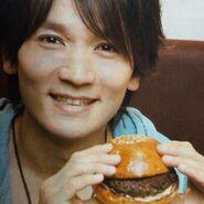 Hiroshi shows a burger