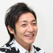 Takeshi Tsu smiles