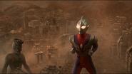 Ultraman Tiga places his hands