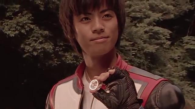 File:Tsubasa with his photograph.png