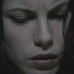 Selene stares at Lucian's flesh.
