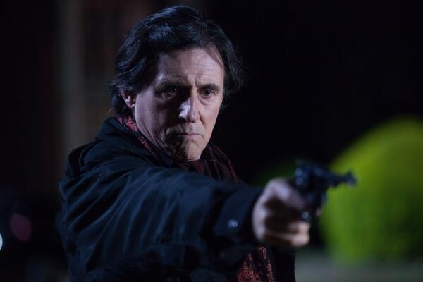 File:Victor holding a gun.jpg