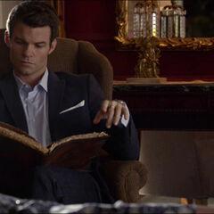 Elijah reading one of Esther's grimoires