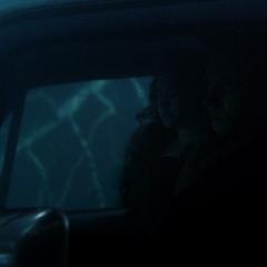 Elena in the car with Matt