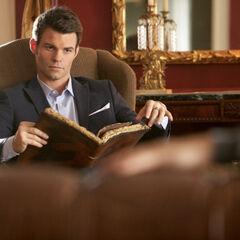 Elijah reading Esther's grimoire