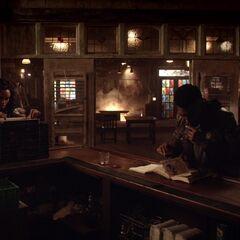 Vincent studying his grimoire