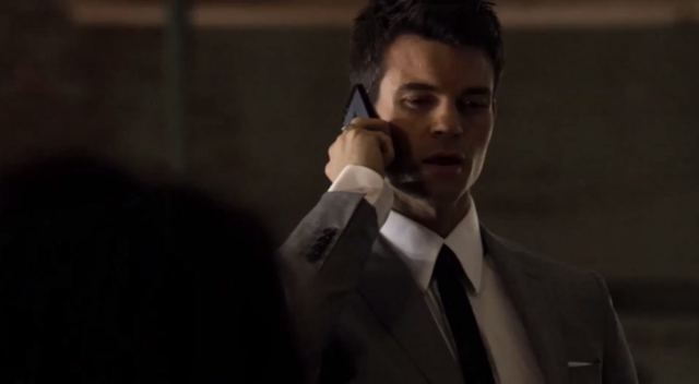 File:Elijah talking with Hayley on the phone 1x21.png