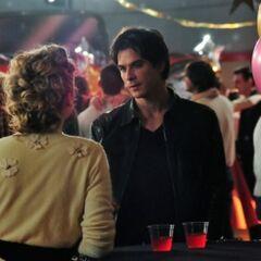 Damon asking Caroline for a dance.