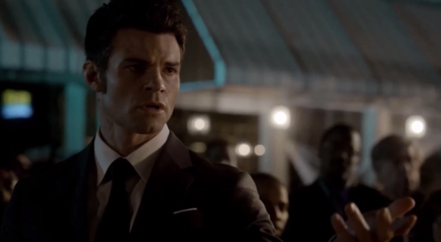 File:Elijah offering his hand to Hayley 1x22.png