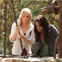 Bonnie helping Caroline pull Stefan out of a vervain filled well.