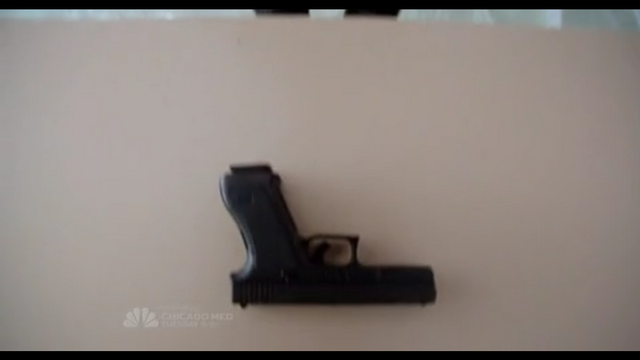 File:With gun.png