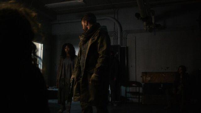 File:Help Out 1x09 Taka questioning Quaid as Sheema watches.jpeg