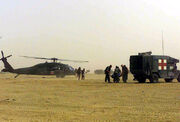 US Navy 030331-M-6910K-021 U.S. Navy Corpsmen transport wounded from an Army Medical Evacuation H-60 Black Hawk helicopter