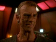 Dukat posing as Anjohl Tennan