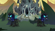The changeling guards outside the hive, unaware of Starlight, Trixie, Thorax and Discord