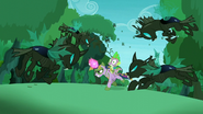 The changelings fly to attack Twilight and Spike