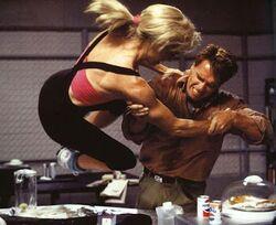 Lori wrestles Quaid