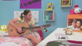 Fran playing the guitar