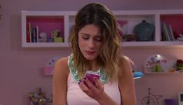Vilu at her phone