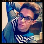Ruggero wearing glasses