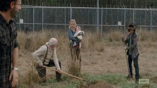 File:Beth watching the others digging while shes holding Judith.JPG