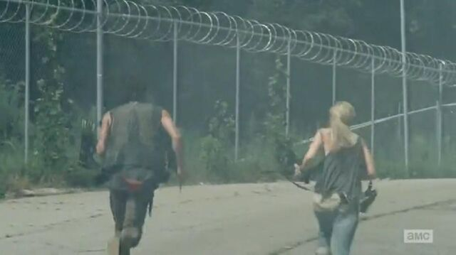 File:Daryl and Beth running from the prison into the unknown.JPG