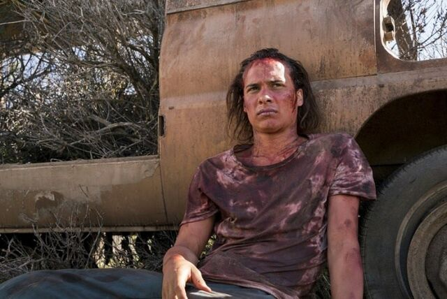 File:Fear-the-walking-dead-grotesque-review-nick-against-car.jpg