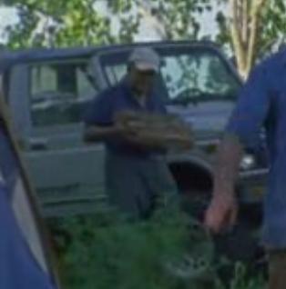 File:Joe H carrying wood (Vatos).png