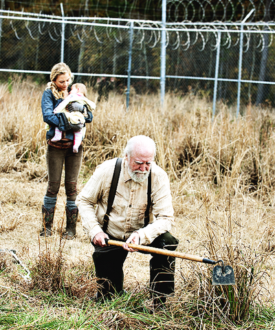 File:Beth carrying Judith while Hershel plow the land with one foot.png