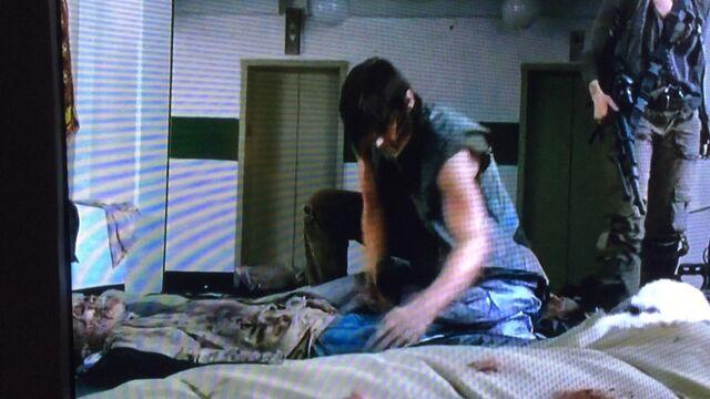 File:Daryl checking pockets.jpg