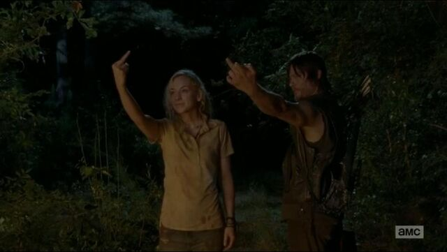 File:Beth and Daryl middle finger to the fire.JPG