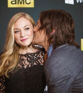 Emily with Norman who is about to kiss her on the red carpet