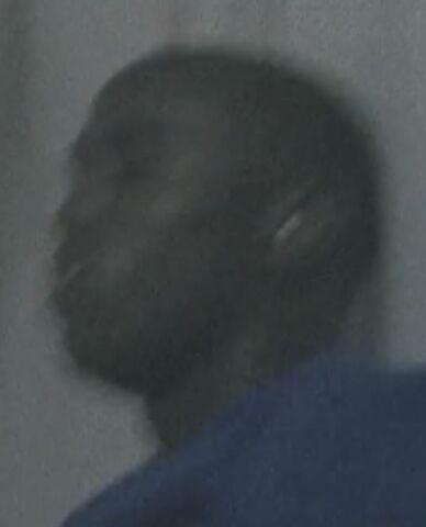 File:Black Guyyyy Wearing a blue shirt.JPG