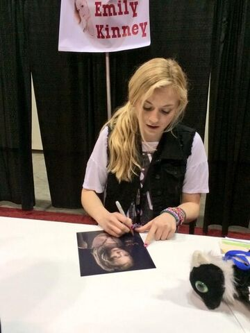 File:Emily Kinney signing her very own badass season 4 photo for a fan.jpg