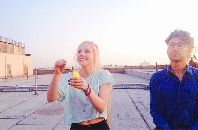 File:Emily blowing bubbles in the morning with a guy so cute.jpg