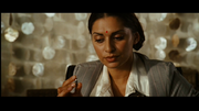 A picture of Puja examining the bullet given to her by Mr. X