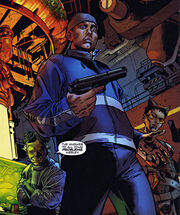 A picture of Wesley nervously holding a gun in his right hand.