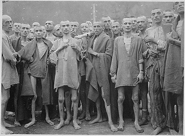 File:Starved prisoners, nearly dead from hunger, pose in concentration camp in Ebensee, Austria.jpg