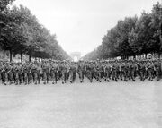 American troops march down the Champs Elysees
