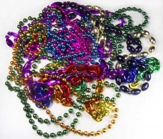 File:5956065-several-strands-of-various-colors-and-shapes-of-mardi-gras-beads-on-white-background.jpg