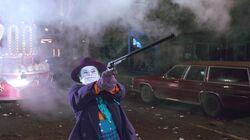 Joker shooting the Batwing