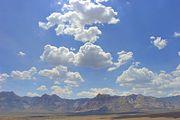 180px-Cumulus mediocris clouds redrock