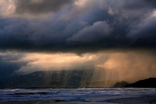 File:Rain on the beach.jpg