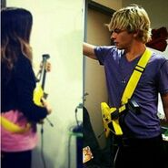 Raura playing guitar hero