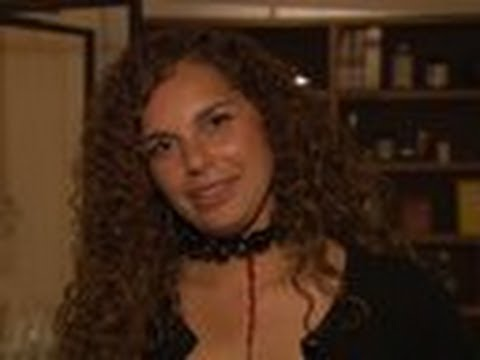 File:Melina - Exit Interview.jpg