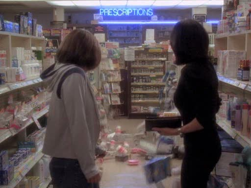 File:Prue moves all items off of shelf.jpg