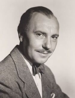head and shoulders image of middle-aged man, slightly balding, with moustache