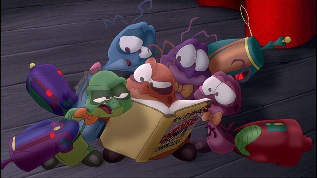 File:The Nerdlucks reading Bugs' rule book.jpg